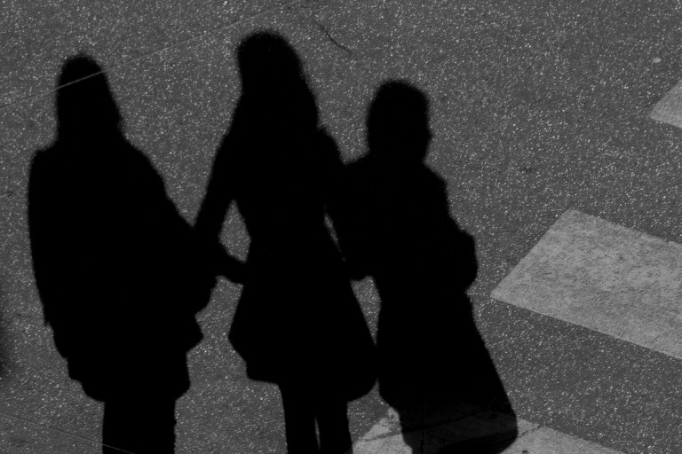 Three women in shadow