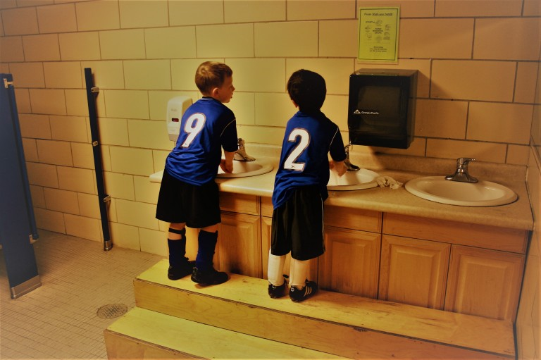 Boys washing hands