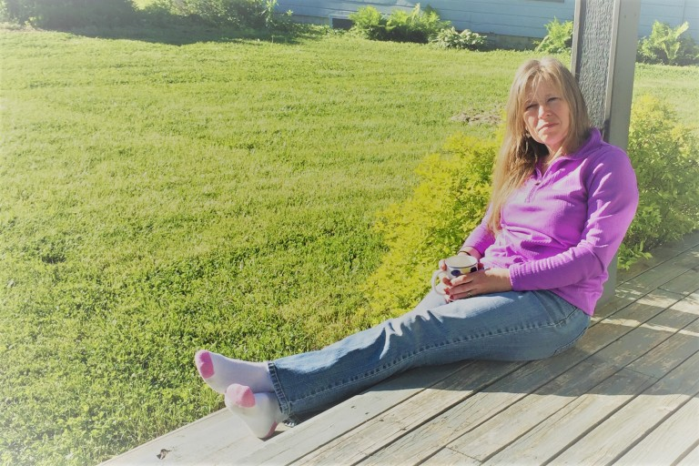 Heather relaxes on a beautiful Ozark morning